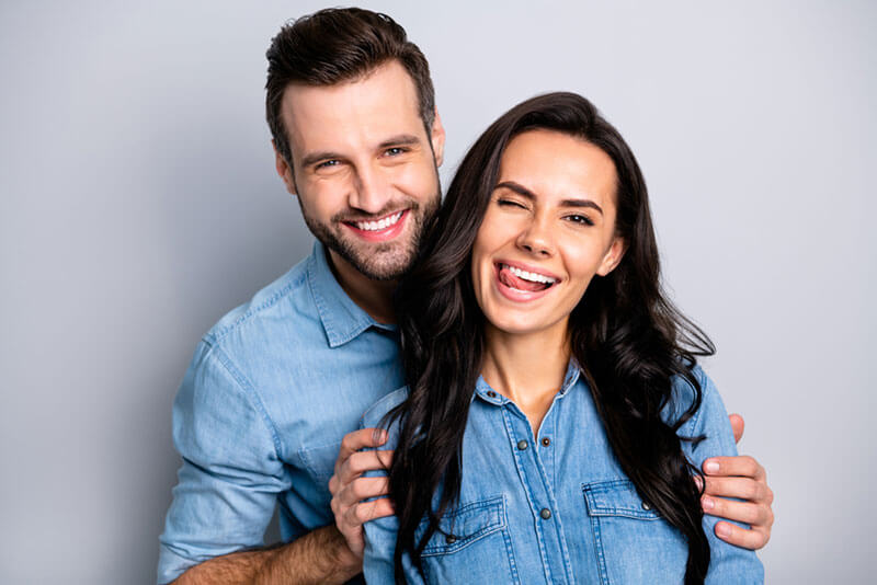 a couple smiling and having fun